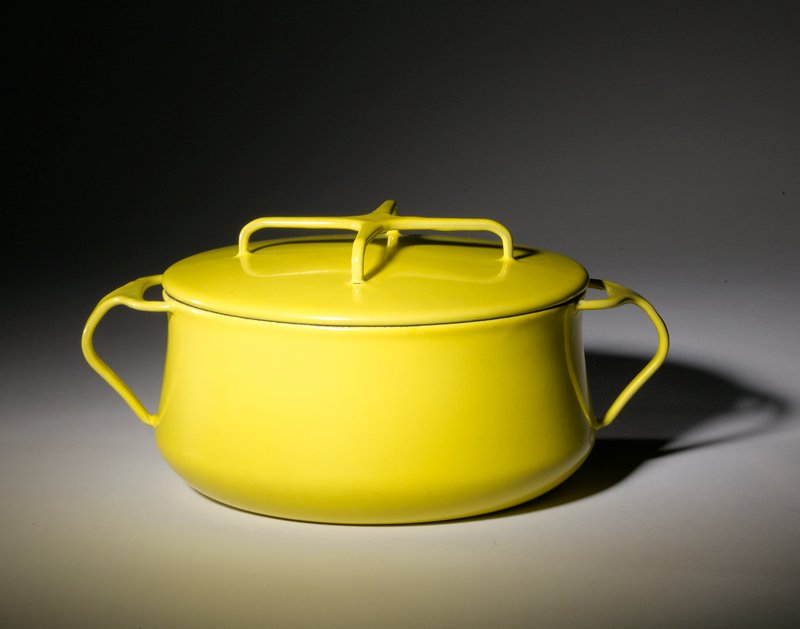 yellow bowl with slightly concave sides; pair of T-shaped handles; cover has handle of X shape; interior of bowl is white