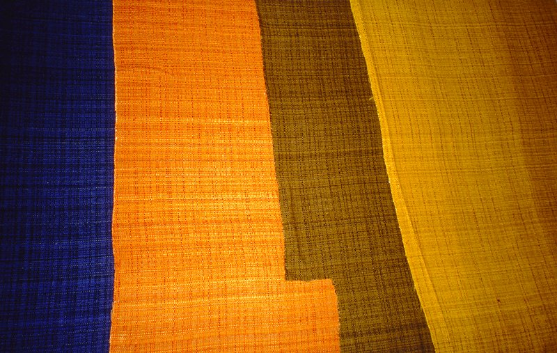 Variation on a plain weave:some thin and thick warp. Over dyed fabric. Cadmium Yellow