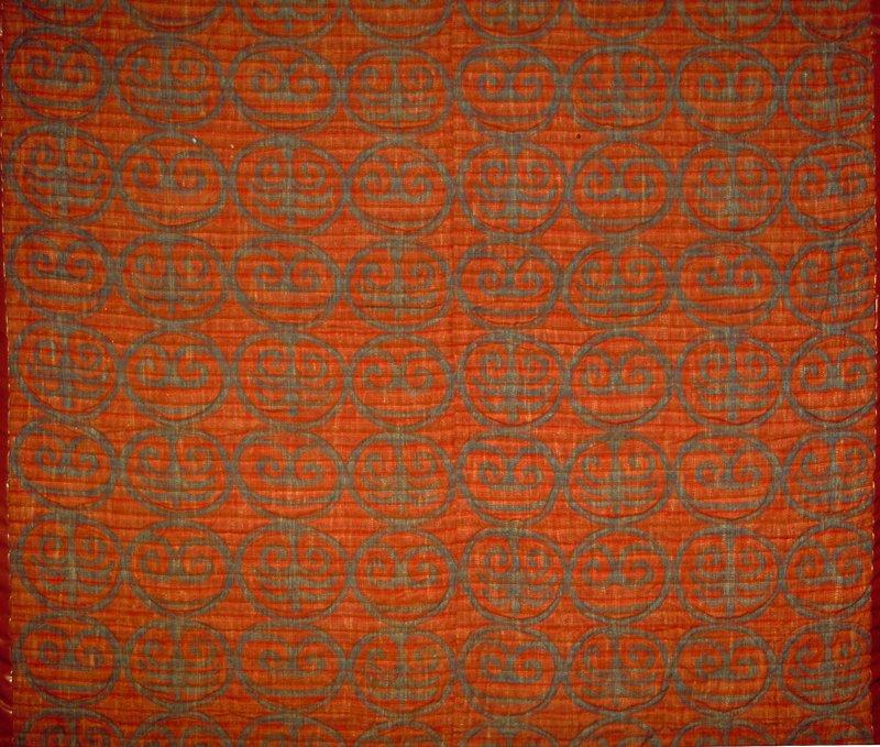 "Warp printed. Scroll pattern. Vert. Rpt. 14.5"". Red & blue Red Earth/Indigo"