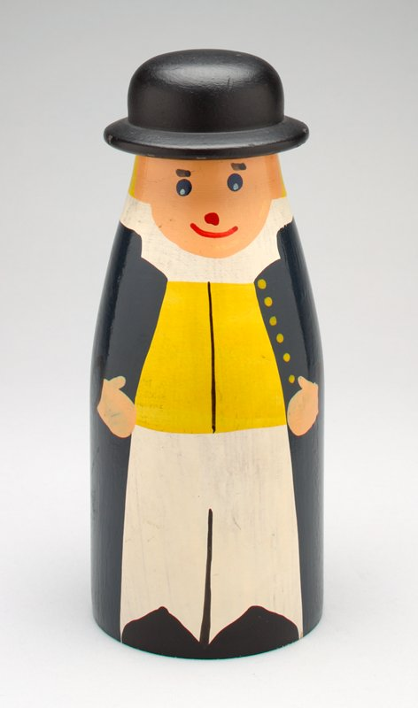 standing male figure with removable black hat; milk bottle-like shape; long blue coat, white pants, yellow shirt, black shoes