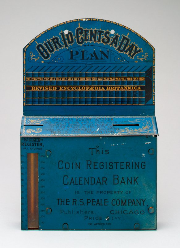 blue metal hanging bank; rectangular box has 2 coin slots in top; hanging section shows books;