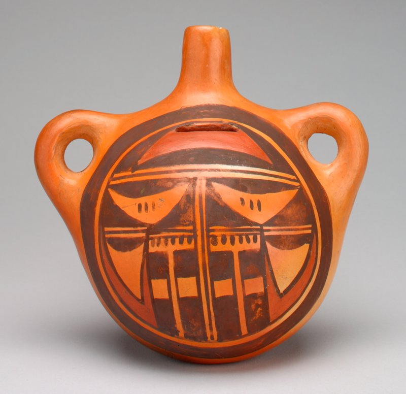 orange ceramic bottle with painted design; handles on either side of spout; does not stand upright, but lies on back; design painted in matte brown and rust;