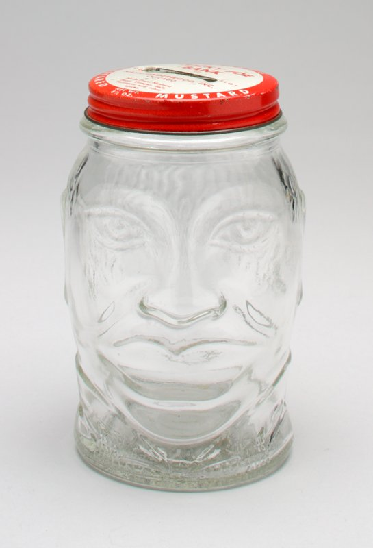 clear glass head mustard jar with red and white metal cap; on cap: 'Nash's/ Prepared Mustard/ Lucky Joe Bank'