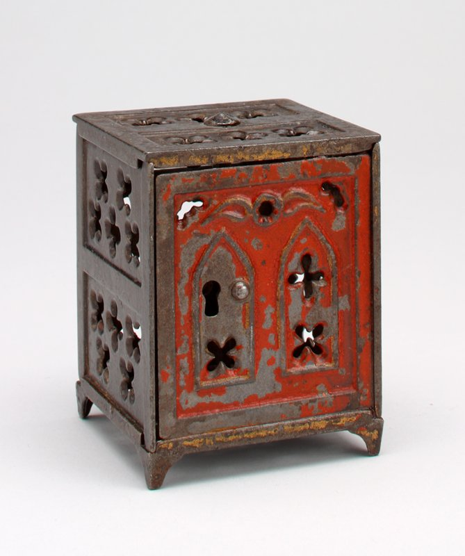 cube shape open work brown safe with red door; coin slot in back
