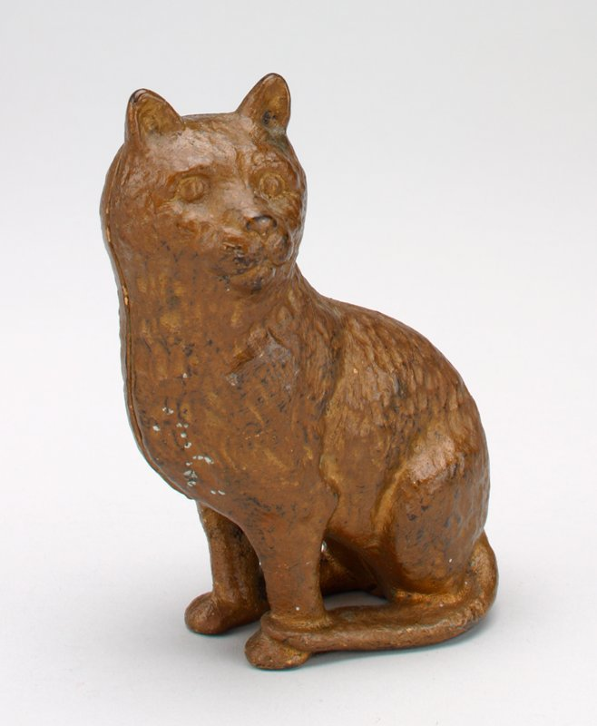 gold seated metal cat; coin slot behind ears