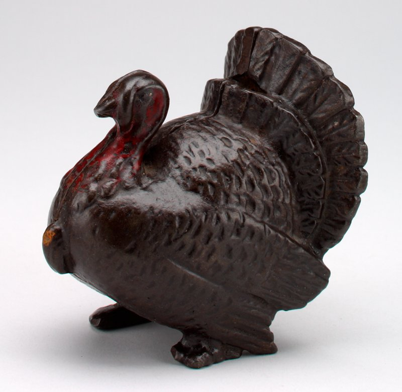metal standing turkey with spread tail; red head and neck