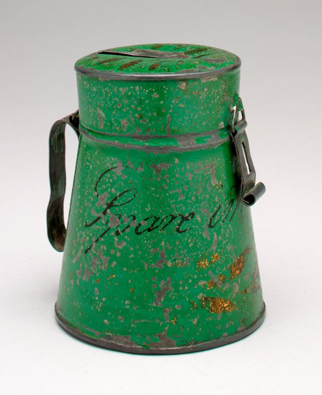 green metal can with gold decoration and illegible writing; handle on the back; top opens; hasp on front of top; coin slot on top