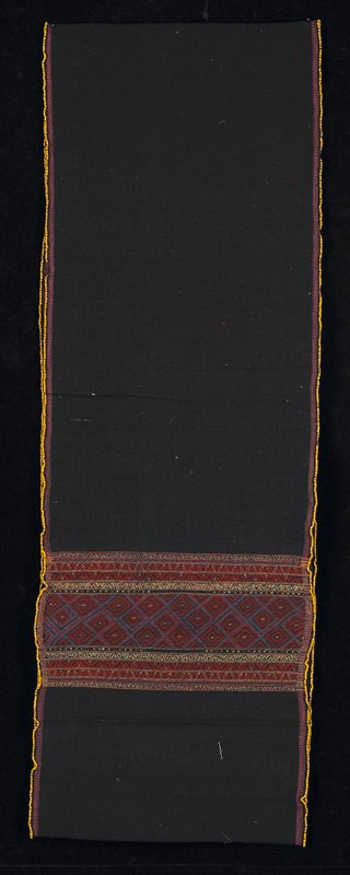 loop of dark blue fabric; yellow bead trim; pink and brown stripes at edges; wide decorative band in mustard, red, blue and orange