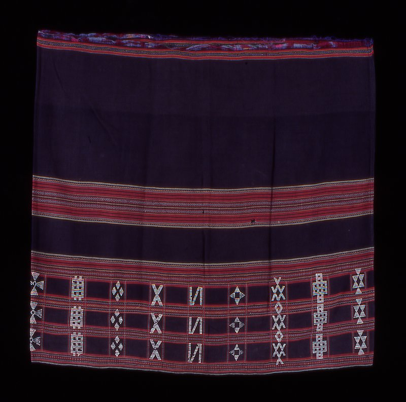 predominately brown with striped; hem embellished with beads in geometric designs