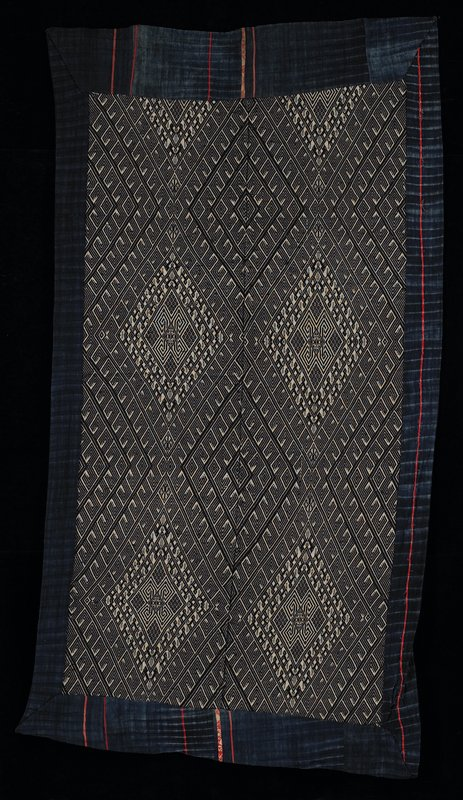 blue backing and trim, with red applique accents; black and white woven center panel with diamond motif geometric designs