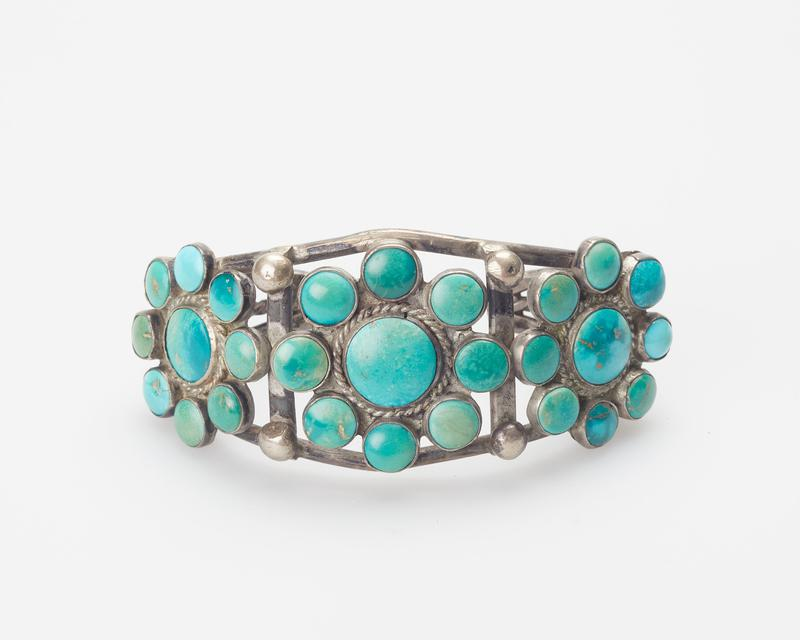 2 wires with twisted wire between them, 3 clusters of turquoise; consisting of 27 stones in all