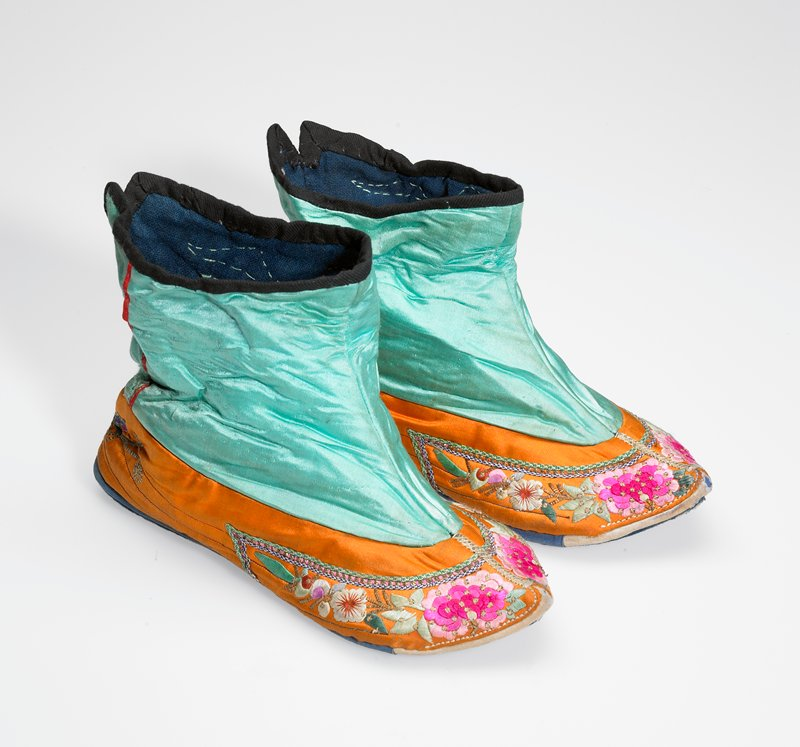 lightly quilted turquoise and orange silk with floral embroidery around sole line; pointed toe; top edged in black