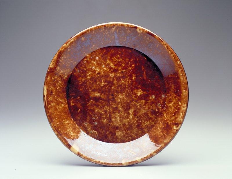 mottled brown and white glaze