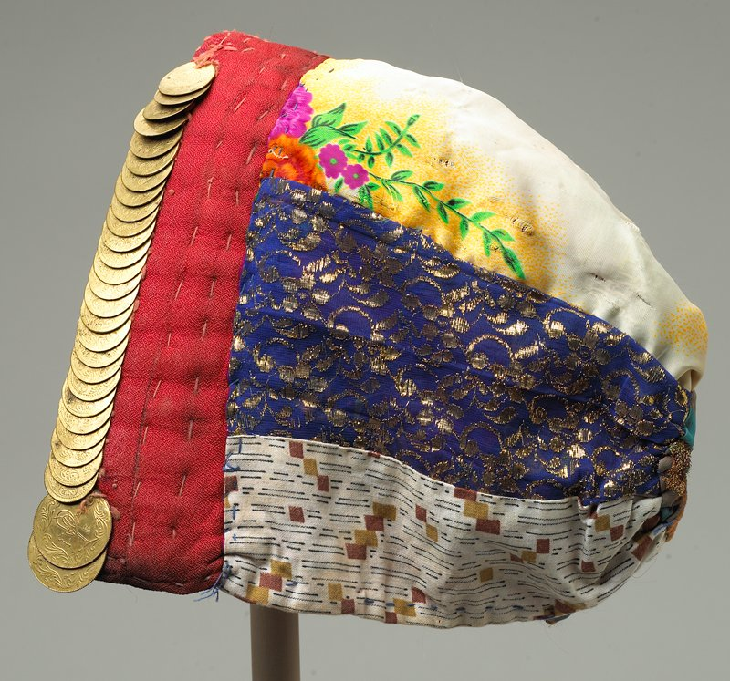 lined six-gored hat with variety of prints; red padded front band decorated with gold ottoman coins
