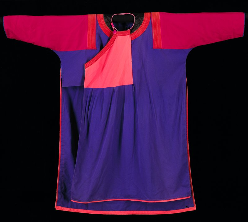 loose purple tunic with long side vents with orange binding and red sleeves; right front diagonal opening--orange; neck and shoulders have woven tape trim--red and metal thread with insert of black satin; metal bead and yarn closure at neck