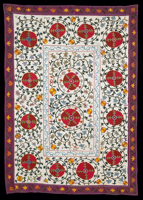 Printed lining with ikat band on reverse edge. Red dominates, polychrome silk embroidery on white morey silk ground, applied wide purple border also embroidered (silk). Four vertical panels. Cotton print lining edged with wide strips of silk ikat. Velcro heading band attached.