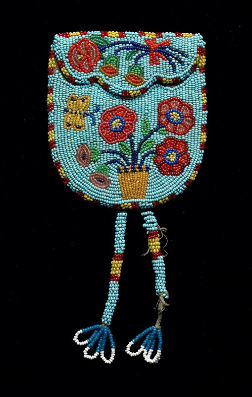 small flap pouch with two long beaded tassels; light blue ground; beaded overall on front with pot of flowers and butterfly; flower bouquet on flap
