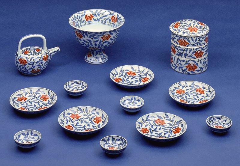 eighteen piece sake, porcelain in peony pattern, underglaze blue with overglaze enamels; see following card for list of objects