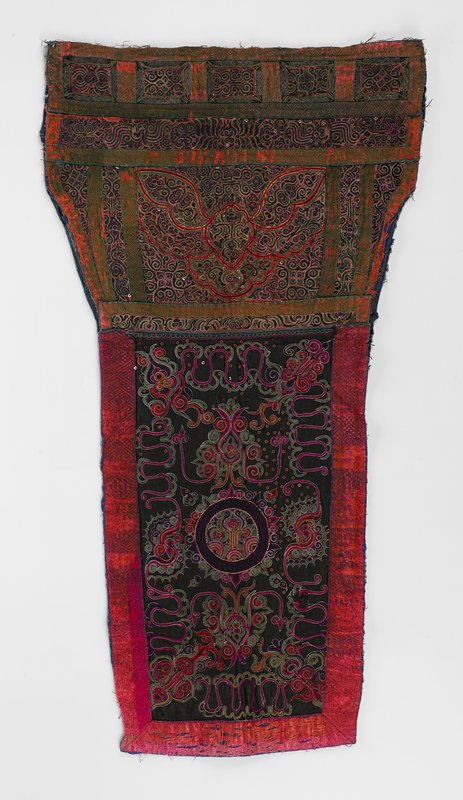 blue lining; lower panel fully embroidered in braid and outline technique in scroll patterns in maroon, red, green, black; center rectangle and other sections are divided by woven embroidered bands; upper panel is black satin with elaborate floral embroidery surrounding center circle; red, green, maroon, orange, purple with wrapped metal outlining, metal tape and sequins; bordered on three sides by wide woven embroidered band in red