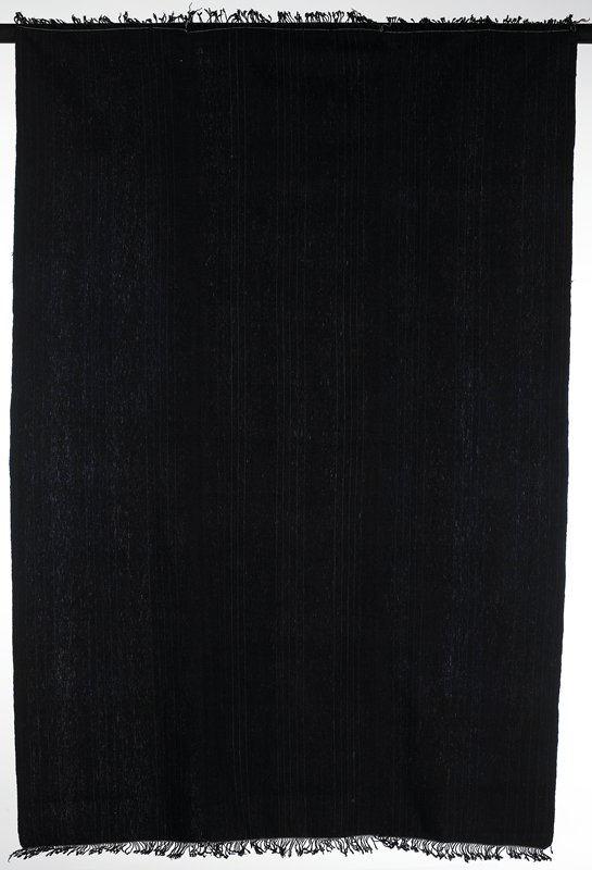 three panels hand stitched together; dark indigo with thin lighter blue stripes; warp fringe twisted and knotted at both ends; plain weave