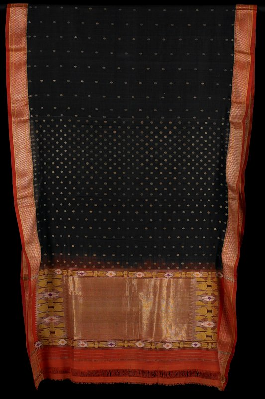 tapestry; brocade; face dyed (on orange); geometric patterning down edges in metallic thread; body of textile is deep indigo with small circles of metallic; wide area of tapestry at ends