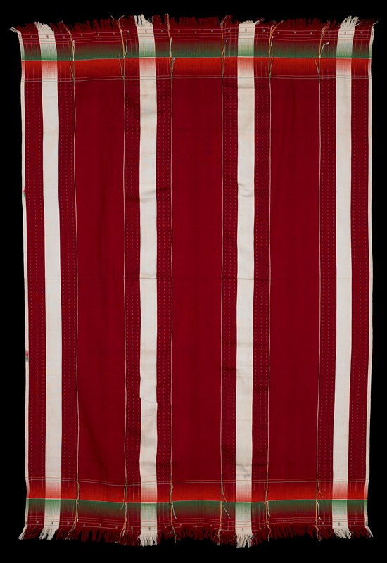 red with four bands of white running though the length; ends are finished with green and orange patterning with fringe