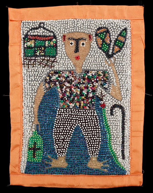 beaded and sequined panel with orange trim and backing; standing figure wearing a short-sleeved multicolored shirt and black and white pants; cane and snake, LRC; birdcage (?), ULC; bottle (?), LLC