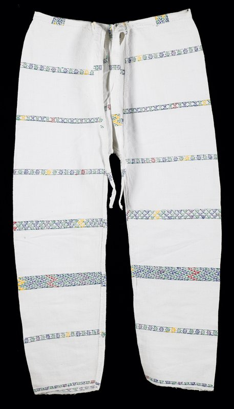 white woven long pants with open front placket with tie; narrow strips of supplementary weft design in red, green, yellow, purple