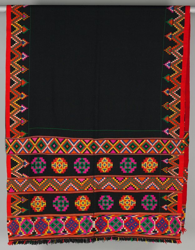 "two fine woven panels, hand sewn with black background; each panel has a woven multicolored side border (6"") and horizontal multicolored bands in different geometric pattern at each end; attached mostly black fringe"