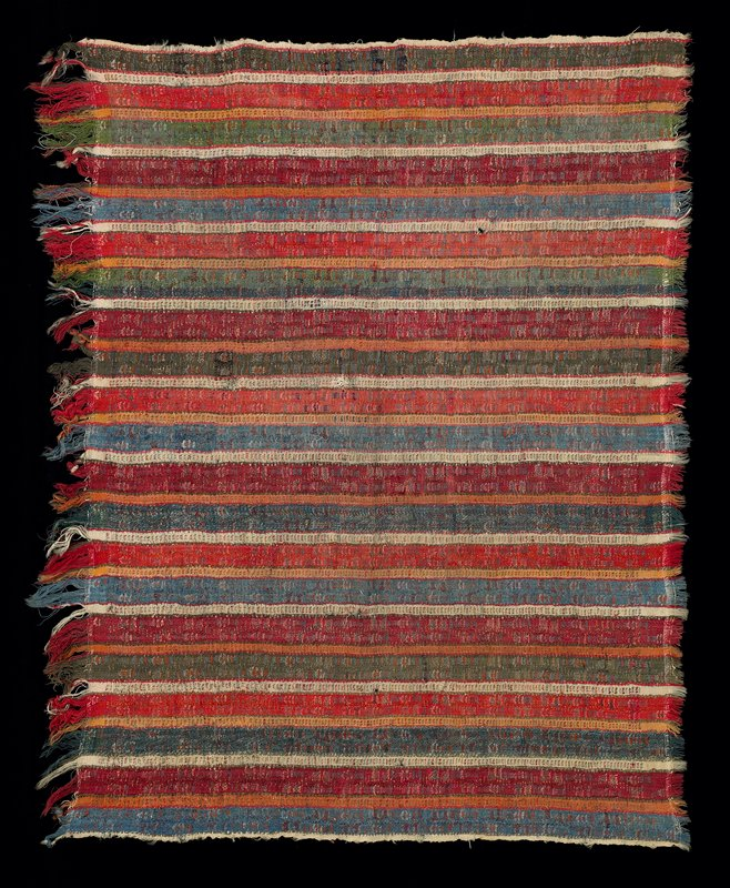 "coarse wool; woven stripes; double weft interlock weave; discontinued supplementary weft; twill; 2"" fringe on one side; green, red, blue, off white"
