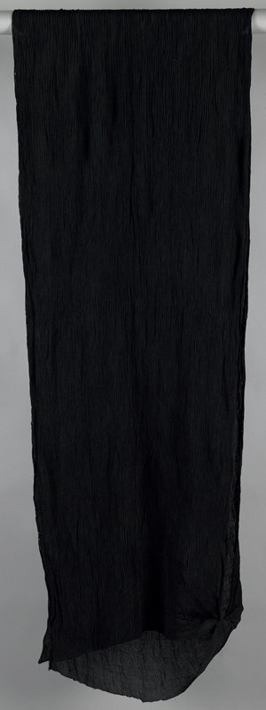 black silk (?); crimped; long rectangle