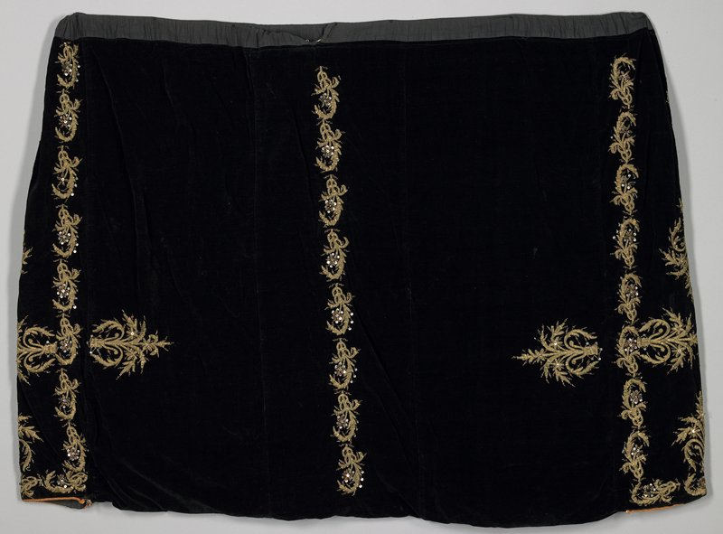 black velvet with gold embroidery; black cotton waistband tube for sash; white muslin lining throughout shalvar of black cotton velvet with heavy raised bands of vertical and gold embroidery; horizontal embroidered motif at side