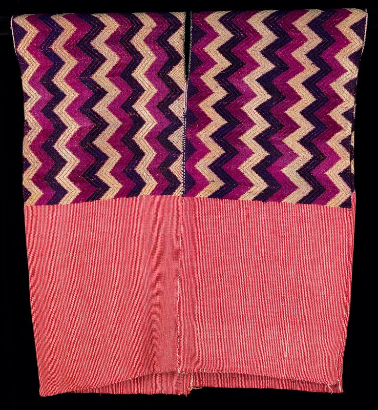 """four woven panels, hand sewn joining; 7"""" neck opening; 5 """" side opening; upper half supplementary weft in vertical zigzag pattern deep purple, magenta and off-white; lower half in narrow red and white vertical stripes"""