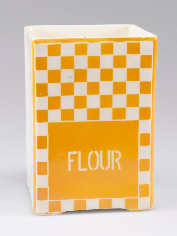 "open square container; porcelain with one side decorated with yellow-orange and white checkerboard and ""FLOUR"" in white"