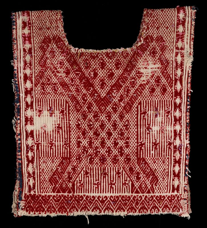 red with white embroidered designs of small diamonds, crosses and stripes; neck opening is outlined with chain-stitch embroidered, pointed designs