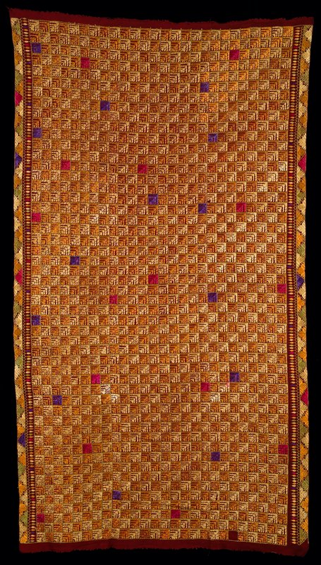 "solid 1 3/4"" squares with silk leaf embroidery on rust wool (?) woven cloth; vertical sides have borders with leaves and flowers; embroidery is satin stitch in gold, yellow, with random purple, cerise and olive green; three panels hand stitched together"
