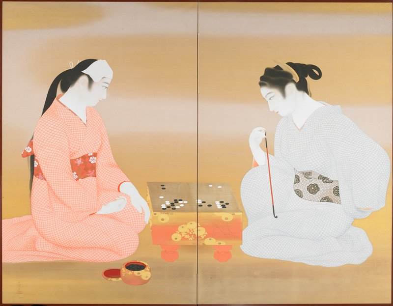 two kneeling women (one wears peach and white kimono, other wears light blue and white kimono), with a Go board between them; board platform and vessel for playing pieces is blush pink with tan and brown flowers; woman at R holds a thin brown and black pipe; two fold screen