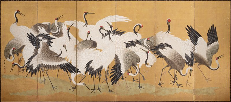 flock of white and grey cranes, some with red at eyes and forehead, against a gold background; cranes stand, preen, and walk